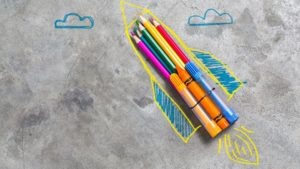 Back to school concept. rocket made from pencils, crayons and chalks